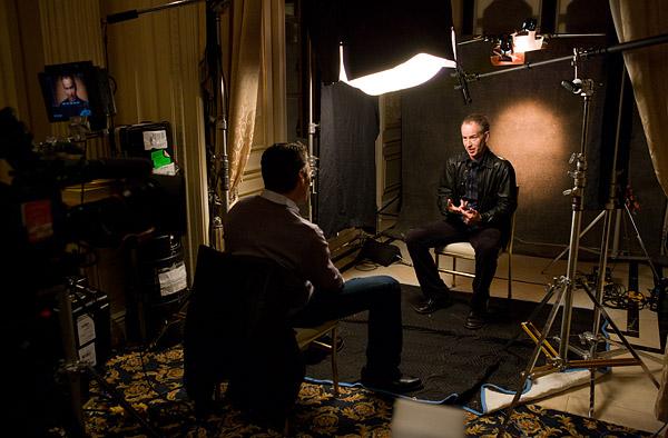 John McEnroe tapes a television segment at the press conference