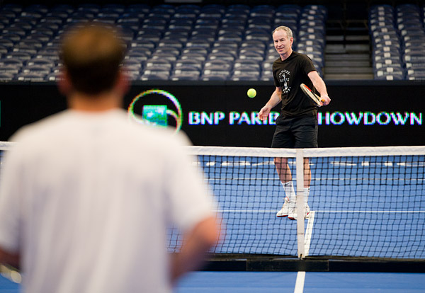 McEnroe practices with Pete Sampras in the afternoon. McEnroe hurt his ankle at the end of the practice session, which forced him to withdraw from his 8-game pro set with Ivan Lendl while leading 6-3.