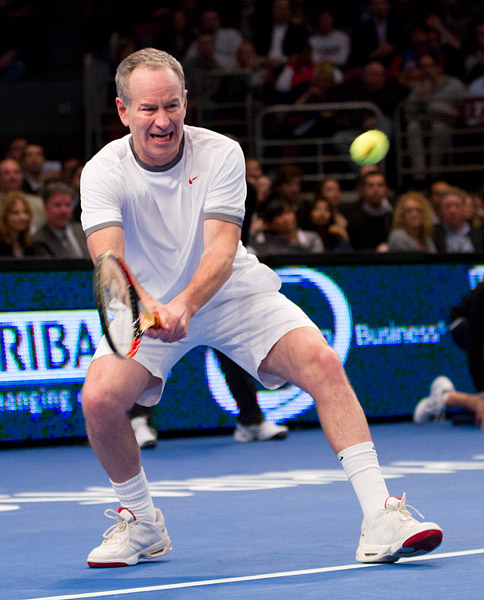 John McEnroe plays through the pain in his left ankle