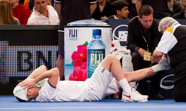 McEnroe receives treatment on his ankle in between games