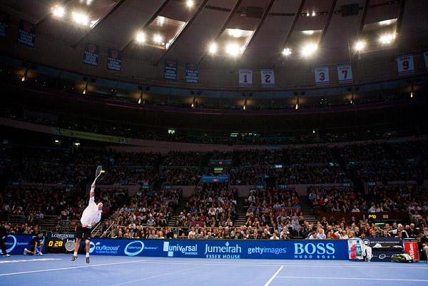 Ivan Lendl serves against John McEnroe in the first match