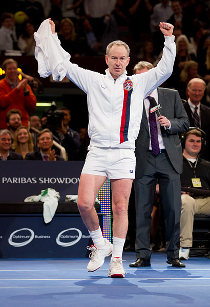 Always full of surprises, McEnroe reveals his 80's era short tennis shorts during the post-match interview