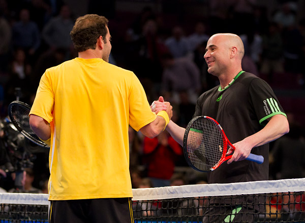Agassi congratulates Sampras on his victory