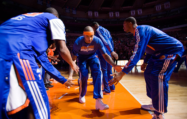 New York's Carmelo Anthony low-fives teammates during pre-game player introductions