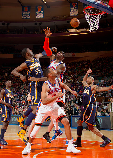 The Knicks' Amar'e Stoudemire and Pacers' Roy Hibbert jump for a rebound while (L to R) Darren Collison, Jared Jeffries and Dahntay Jones look on