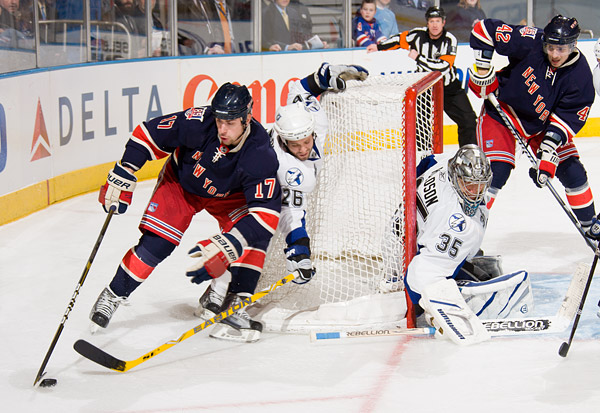 Brandon Dubinsky attempts to score against Tampa's Martin St. Louis and goalie Dwayne Roloson late in the third period