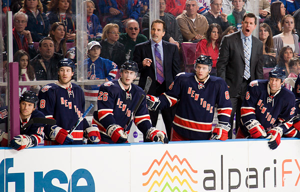 Rangers head coach John Tortorella, assistant coach Mike Sullivan, and the Rangers bench look down ice as their team tries to tie the game in its final moments