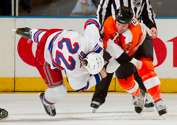 New York's Brian Boyle takes a punch from Philadelphia enforcer and former teammate Jody Shelley