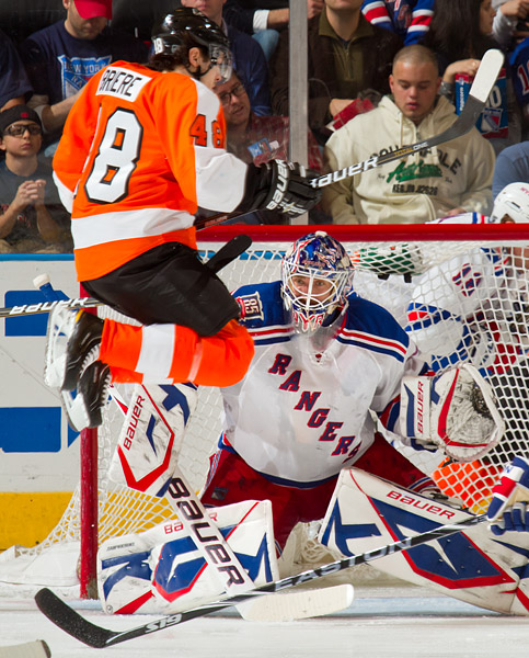 Rangers goalie Henrik Lundqvist is screened by the Flyers' Danny Briere