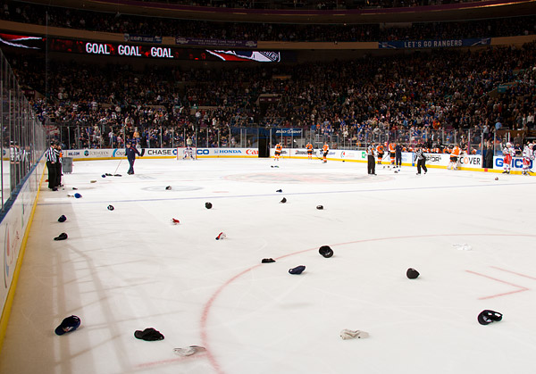 leading to an unusually large flurry of hats on the ice to commemorate the fan favorite's first career hat trick