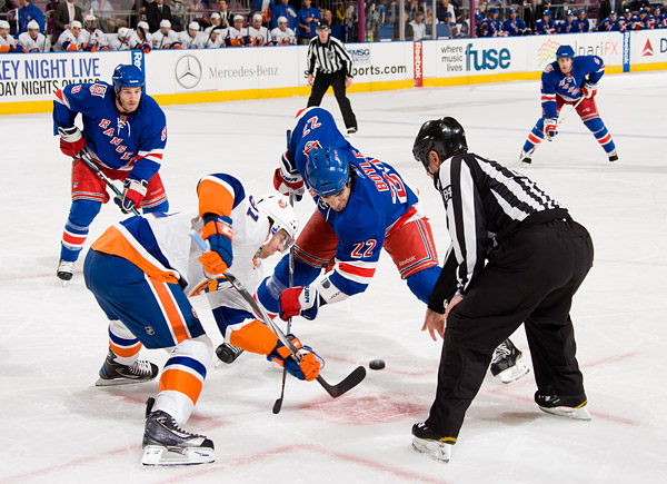 The Islanders' John Tavares and Rangers' Brian Boyle take a faceoff