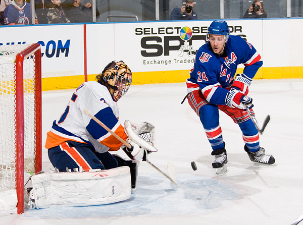 Islanders goalie Al Montoya, who was a Rangers first round pick in 2004 NHL Entry Draft, makes a stop against Ryan Callahan