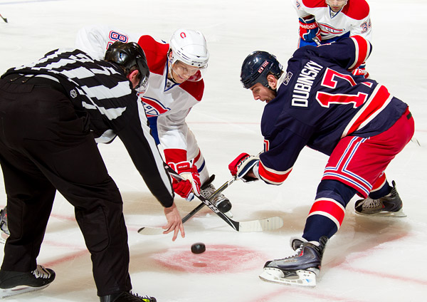 Montreal's Lars Eller and New York's Brandon Dubinsky take a faceoff