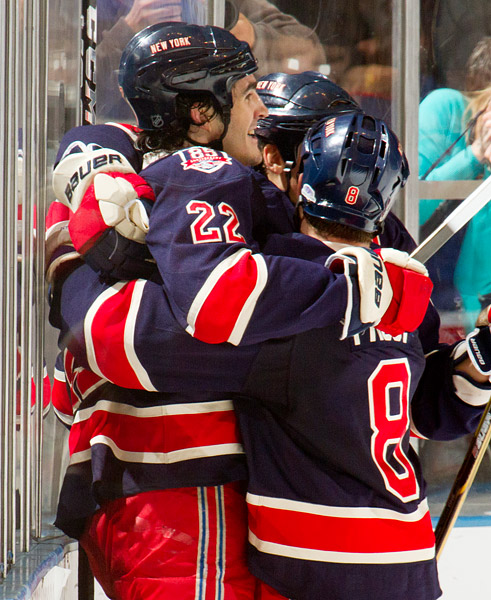 Brian Boyle (#22) is congratulated by teammates after scoring the fifth Rangers goal of the period
