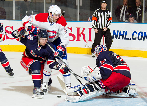 Ranger defenseman Steve Eminger and goalie Henrik Lundqvist defend against Montreal's Benoit Pouliot