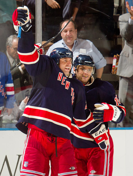 Vinny Prospal celebrates with teammate Marian Gaborik after scoring the sixth and final goal for the Rangers