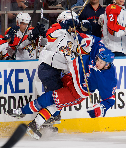 A Panther checks the Rangers' Derek Stepan