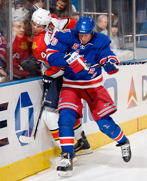 The Rangers' Vinny Prospal checks the Panthers' Keaton Ellerby into the boards