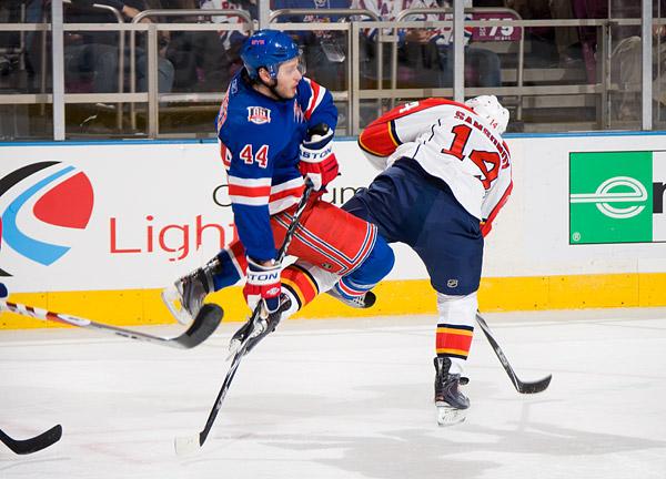 New York's Steve Eminger gets some air courtesy of Florida's Sergei Samsonov