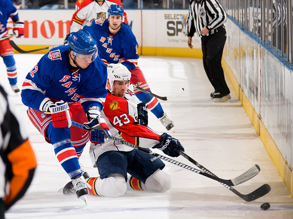 New York's Artem Anisimov and Florida's Mike Weaver