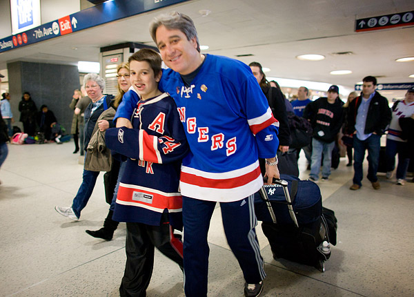 A father and son head to the Boston-bound train in New York's Penn Station