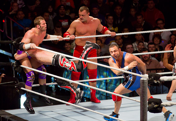 Santino Marella throws Evan Bourne into Zack Ryder while Vladimir Kozlov looks on