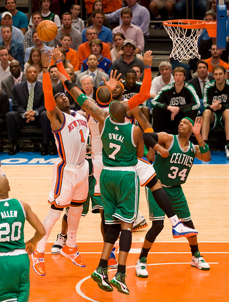 New York's Amar'e Stoudemire (#1) battles for a rebound
