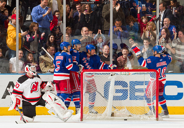 Martin Brodeur, the Devils franchise goalie since 1993, can only look on as Vinny Prospal (third Ranger from left) celebrates his goal with teammates and fans, giving the team a solid 5-2 lead. Brodeur and the Devils will miss the playoffs this season for the first time since 1996.