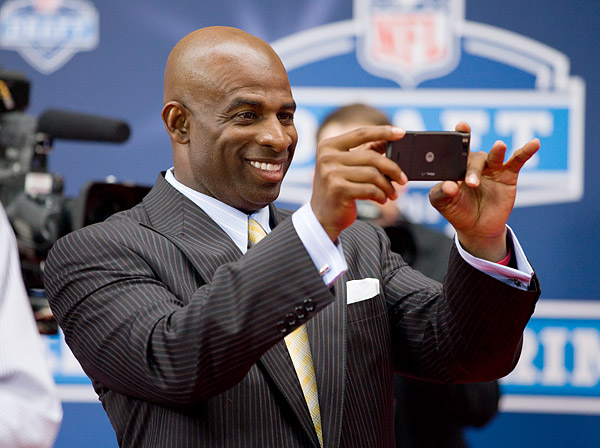 Deion Sanders, newly elected to the Pro Football Hall of Fame, snaps some pics
