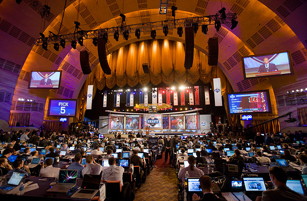 An endless number of laptop screens dot the press section at the Draft