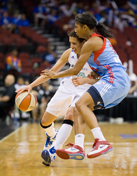 New York's Nicole Powell led the game in scoring with 20 points, seen here with Atlanta's Angel McCoughtry