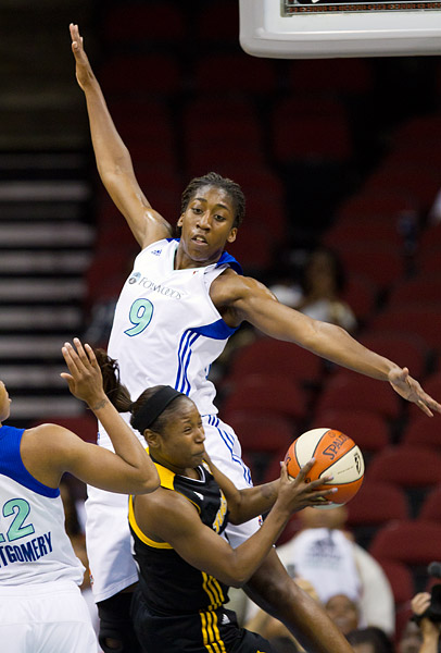 Quanitra Hollingsworth uses her entire 6-foot 5-inch frame to defend against a Tulsa player