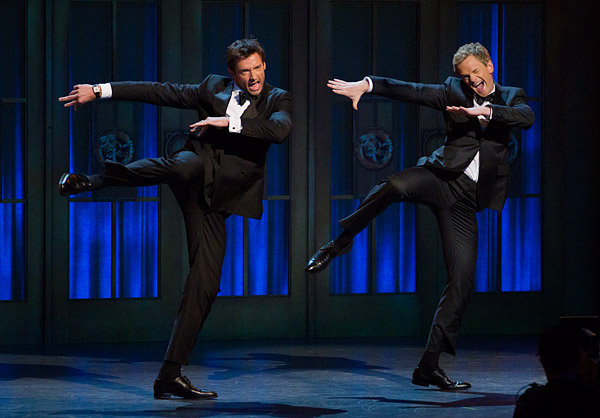 Hugh Jackman and host Neil Patrick Harris in a mock dance-off