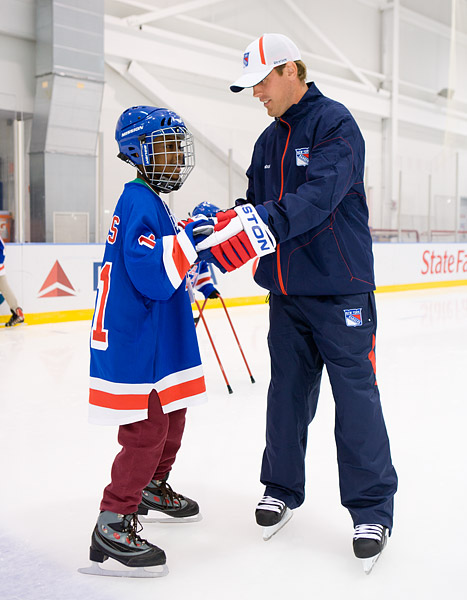 Brad Richards, a star player (and former Dallas Star) recently acquired by the Rangers, helps a new skater