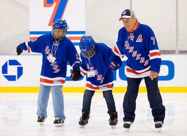 Rangers legend Rod Gilbert joins the kids on the ice