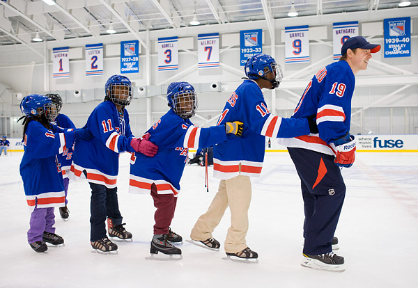 Rangers player Ruslan Fedotenko leads a conga line on the ice at the Madison Square Garden Training Center