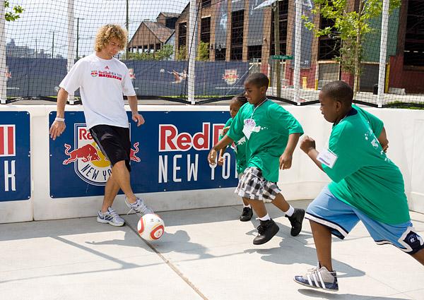 Stephen Keel runs a soccer game