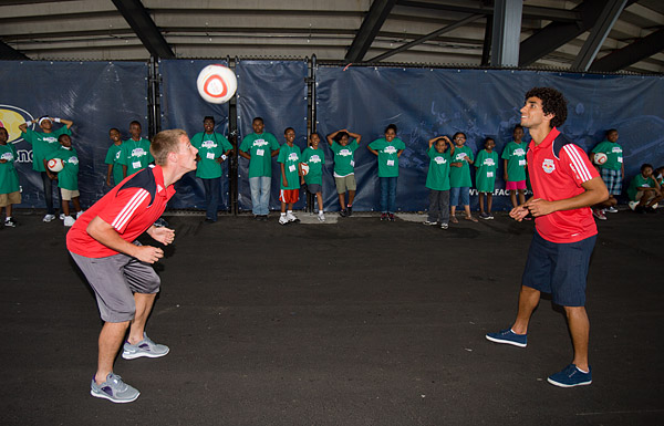 Red Bulls players Jan Gunnar Solli and Mehdi Ballouchy demonstrate proper heading technique