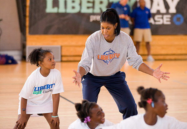 Assistant coach Monique Ambers teaches defensive skills