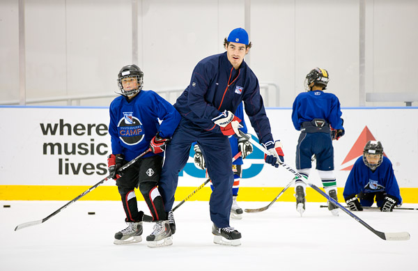 Rangers player Brian Boyle spends time with campers on the ice and signs autographs