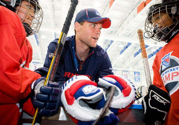 Defenseman Michael Sauer chats with campers