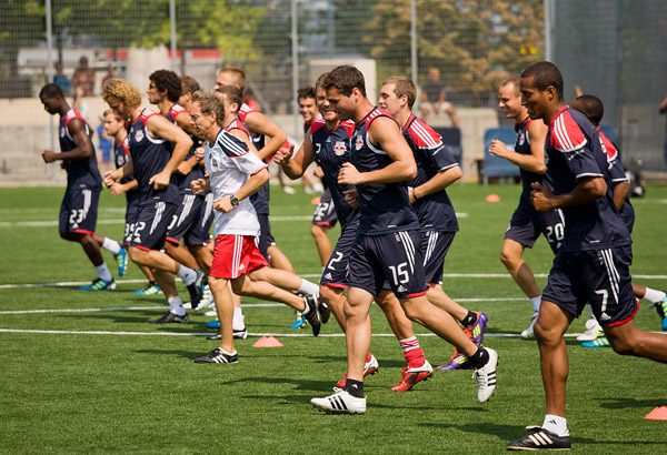 Red Bulls soccer team sprints down the field