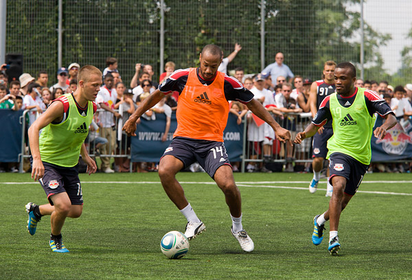 Red Bulls star Thierry Henry shows off his moves for teammates Tyler Lassiter and Dane Richards