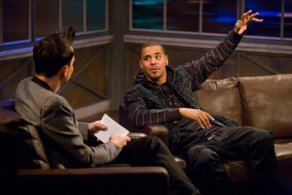 J. Cole being interviewed by Mark Hoppus