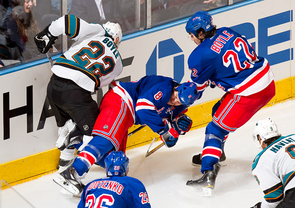Brandon Prust gets a taste of a #22 Boyle sandwich between San Jose's Dan Boyle and New York's Brian Boyle