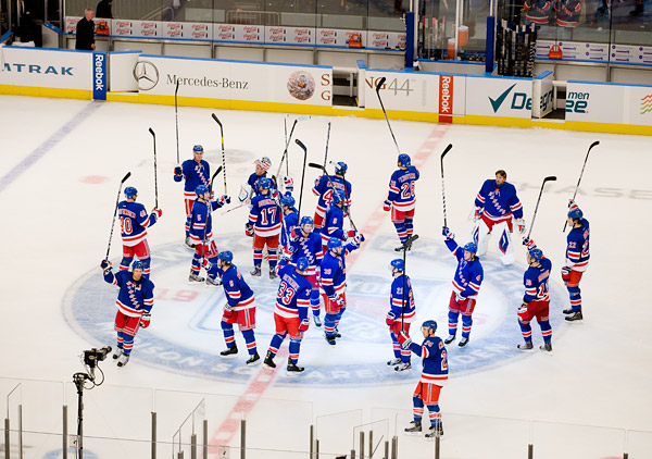 The Rangers salute the fans at center ice following the win