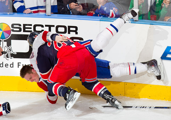 Rangers captain Ryan Callahan takes down Canadien Mike Blunden in a fight