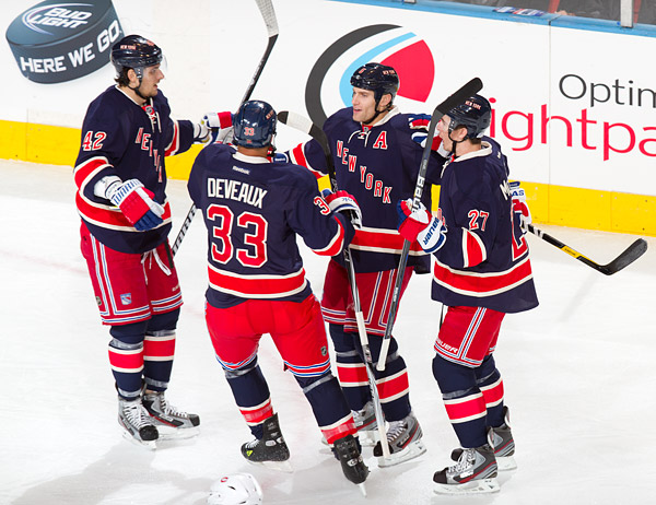 Dan Girardi celebrates his first period goal with Rangers teammates Artem Anisimov, Andre Deveaux and Ryan McDonagh