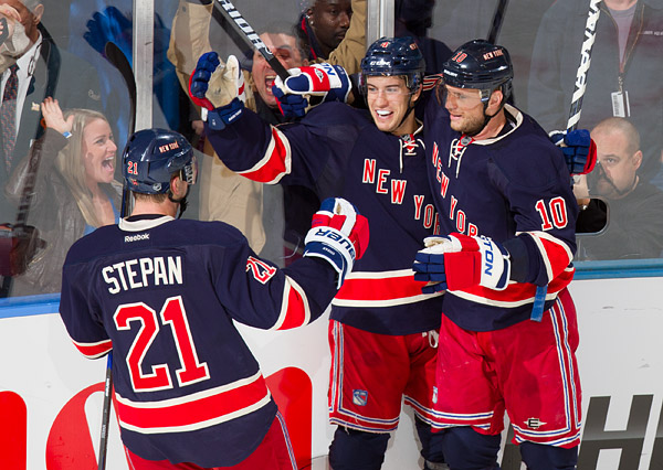New York's Michael Del Zotto (center) celebrates his goal with teammates Marian Gaborik and Derek Stepan