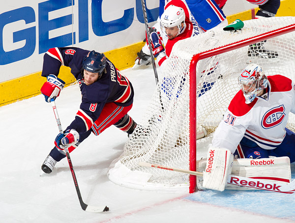 The Rangers' Brandon Prust attempts a wraparound goal against Canadiens goalie Carey Price